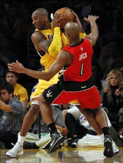 Lakers guard Kobe Bryant, left, scored a game-high 32 points including the game-winner in a 109-107 win over the Raptors.