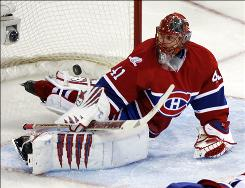 Canadiens goaltender Jaroslav Halak lets in the first goal by the Tampa Bay Lightning's Steven Stamkos, not shown, during the second period Tuesday night in Montreal. Halak saved 28 shots.