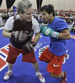 Freddie Roach, left, works out with Manny Pacquiao this week in Grapevine, Texas. Pacquiao meets Joshua Clottey for the welterweight title Saturday night.