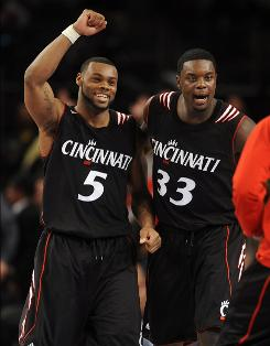 Cincinnati's Deonta Vaughn, left, and Lance Stephenson celebrate after they dispatched Louisville, earning the Bearcats their second victory in Big East tournament history.