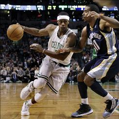 Celtics guard Rajon Rondo drives against Grizzlies guard Mike Conley during the first quarter Wednesday night in Boston. Rondo tied with Ray Allen for most Celtics points with 17.