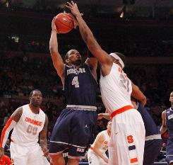 Georgetown guard Chris Wright drives to the basket against Syracuse center Arinze Onuaku during the Hoyas' quarterfinal defeat of the Orange in Big East tournament.