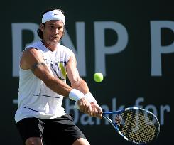 Former world No. 1 Carlos Moya hits a backhand during his first-round match against Tim Smyczek at the BNP Paribas Open.