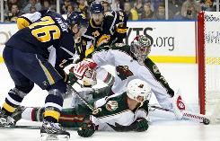 Wild goalie Josh Harding denies Sabres left wing Thomas Vanek during the second period. Harding made 43 saves in Minnesota's victory.