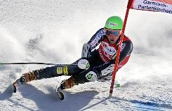 Ted Ligety moves to a third-place finish in the giant slalom and a second career season title in the discipline.