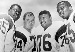"In 1964, Merlin Olsen, second from left, joined Los Angeles Rams teammates Lamar Lundy, Rosie Grier and David Deacon Jones to make up the ""Fearsome Foursome,"" pro football's most famous defensive line."