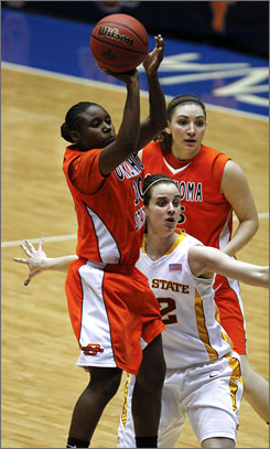 Oklahoma State guard Andrea Riley, shooting over Iowa State's Jessica Schroll, center, as teammate Lindsey Keller watches, scored 43 points and set three Big 12 records in the process.