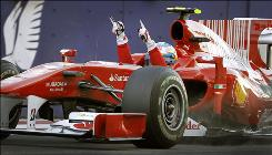 Fernando Alonso celebrates after crossing the finish line to secure the Bahrain Grand Prix in his first start for Ferrari.