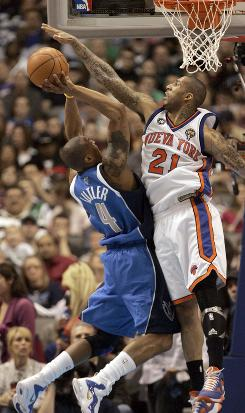 Mavericks forward Caron Butler goes for a shot as Knicks forward Wilson Chandler defends Saturday in Dallas. The Knicks ended the Mavs' 13-game winnings streak, beating Dallas 128-94 after losing by 50 points in the teams' last meeting nearly two months ago.