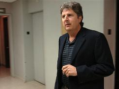 Former Texas Tech football coach Mike Leach arrives to give a videotaped deposition Friday in Lubbock, Texas. Leach is giving sworn testimony in his lawsuit against the school over his firing.