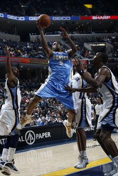 Denver Nuggets guard J.R. Smith (5) shoots goes up for a shot against Memphis Grizzlies guard O.J. Mayo, left, forward Sam Young, center, and center Hasheem Thabeet, right, Saturday night in in Memphis. Smith scored a game-high 30 points as the Nuggets defeated the Grizzlies 125-108.