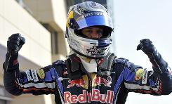 Red Bull driver Sebastian Vettel celebrates after posting the top time in qualifying for the Bahrain Grand Prix.