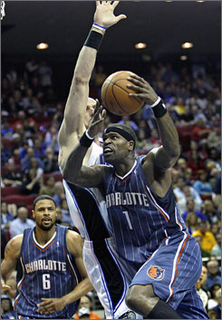 Guard Stephen Jackson, driving on Magic center Marcin Gortat, scored 28 points to lead the Bobcats to a 96-89 win.