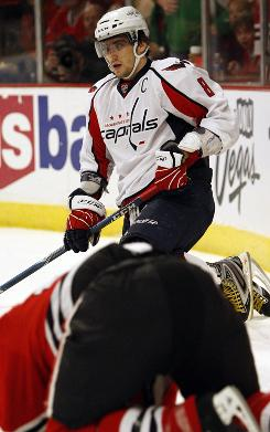 Washington Capitals winger Alex Ovechkin looks at Chicago Blackhawks defenseman Brian Campbell after he checked him during the first period. Ovechkin was ejected.