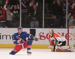 New York's Sean Avery celebrates after scoring his second goal on Sunday.