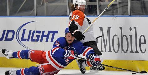 Philadelphia's Scott Hartnell land New York's Sean Avery battle for the puck Sunday.