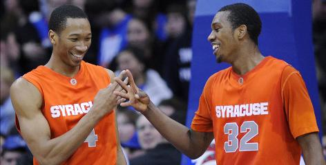 Wes Johnson, left, and Kris Joseph are all smiles as Syracuse enters the NCAA tournament looking to win the school's first national title since 2003.