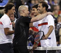Rafael Nadal, from left, Andre Agassi, Roger Federer, and Pete Sampras greet each other after their match at the Hit for Haiti charity tennis event during the BNP Paribas Open at Indian Wells, Calif. on Friday.