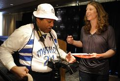 Katie Smith signs an autograph for a fan after a news conference to announce the Washington Mystics' signing of the free agent at the Verizon Center.