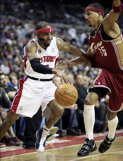 Pistons guard Richard Hamilton drives on Cavaliers forward Jamario Moon in the first half Tuesday night in Auburn Hills, Mich. Hamilton led his team in scoring with 24 points.