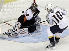 Nashville right wing Martin Erat scores the game-winning shootout goal against Philadelphia goalie Brian Boucher.