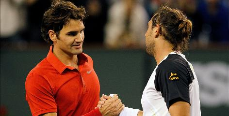Roger Federer, left, shakes hands with Marcos Baghdatis after the Cypriot upset the top-ranked player 5-7, 7-5, 7-6 (7-4) to advance to the fourth round of the BNP Parabas Open at Indian Wells Tennis Garden.