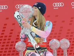 Lindsey Vonn takes the globe for the overall World Cup along with the globes for downhill, super-G and super-combined at season-ending ceremonies in Garmisch-Partenkirchen, Germany.