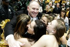 George Mason coach Jim Larranaga celebrates his team's victory over Connecticut which earned a spot in the Final Four in 2006. The ability for a small school like George Mason to make such a run is what makes March Madness so special.