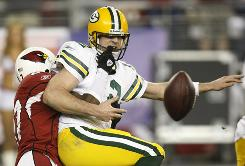QB Aaron Rodgers and the Packers lost a playoff game to the Cardinals in overtime in January after his fumble was recovered for a touchdown by LB Karlos Dansby.