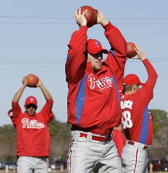 Phillies closer Brad Lidge, stretching last month, hopes to find the form that helped him go 48-for-48 in save chances, including the World Series clincher, in 2008.