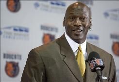 "Former NBA player Michael Jordan speaks during a news conference Thursday in Charlotte. Jordan told reporters and season ticket holders it's a ""dream come true"" to own the Charlotte Bobcats. Jordan is the first former player to own an NBA team, and the second black majority owner. Robert Johnson was the first."