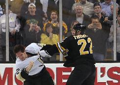 Boston's Shawn Thornton squares off with Matt Cooke in retaliation for the Pittsburgh winger's blindside hit on Marc Savard earlier this month.