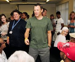 Lance Armstrong talks to survivors during the Livestrong Global Cancer Campaign Launch visit to cancer survivors at Groote Schuur Hospital last week in Cape Town, South Africa.