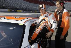 Joey Logano climbs from his car after clocking a pole-winning qualifying lap of 124.630 mph at Bristol Motor Speedway.