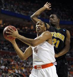 Syracuse's Wes Johnson, rebounding the ball despite pressure from Vermont's Garvey Young during the first half, scored 18 points as the Orange marched into the second round for the NCAA tournament to play Gonzaga.