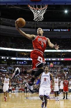The Bulls' Derrick Rose goes up for a shot as Philadelphia 76ers' Andre Iguodala (9) looks on in the second half of Chicago's victory.