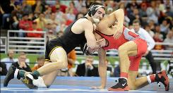 Iowa's Brent Metcalf tries to take down Ohio State's Lance Palmer during the 149-pound final at the NCAA Wrestling Championships in Omaha.