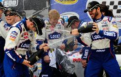Jimmie Johnson, right, sprays crew chief Chad Knaus with champagne in victory lane at Bristol Motor Speedway.