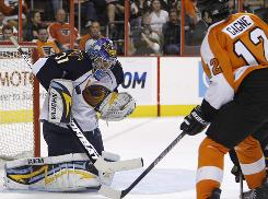 Thrashers goalie Ondrej Pavelec denies the Flyers' Simon Gagne during the second period for one of his 44 saves in Atlanta's win.