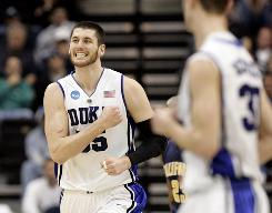 Duke's Brian Zoubek reacts after a play during first-half action against California in the second round of the NCAA tournament in Jacksonville, Fla. Duke pulled away in the second half to snare a 68-53 victory and a spot in the Sweet 16.