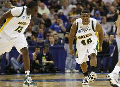 Tweety Carter, right, has helped build Baylor into a contender in the Big 12. This year, he's part of a Bears team that won the school's first NCAA tournament game since 1960 and now readies for a Sweet 16 matchup against Saint Mary's.