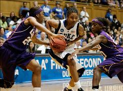 Duke guard Keturah Jackson, center, splits the double team of LSU's Allison Hightower, left, and Destini Hughes during their second-round game in Durham, N.C.