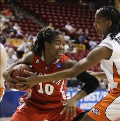 After grabbing a rebound, Georgia's Jasmine James, left, tries to keep the ball away from Oklahoma State's Precious Robinson in the first half. James scored a career-high 27 points and added 10 rebounds in the 74-71 win.