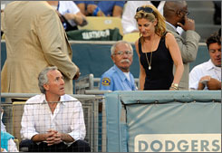 Frank McCourt and his wife, Jamie, didn't sit together at Game 1 of last year's National League Championship Series.