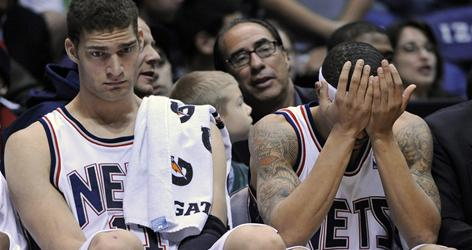 New Jersey's Brook Lopez, left, and Courtney Lee wait out the closing seconds of yet another loss during their lackluster 2009-10 campaign.