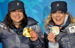 Gold medalist Alana Nichols and silver medalist Stephani Victor celebrate during the medal ceremony after the women's sitting giant slalom.