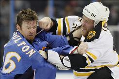 The Thrashers' Eric Boulton, left, and the Bruins' Shawn Thornton duke it out during the first period Tuesday night. Boulton tried to start another fight with Steve Begin later in the game.
