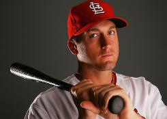 "After a session with Cardinals third baseman David Freese, above, hitting coach Mark McGwire said, ""There is something special about this kid."""