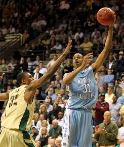 North Carolina's John Henson puts up a hook shot over UAB's Ovie Soko during the Tar Heels' 60-55 win in the quarterfinals of the NIT.