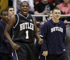 Butler's Shelvin Mack and the Butler bench react after a play in the first half of their stunning upset of No. 1 seed Syracuse.